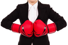 Businesswoman punching red boxing gloves together ready to figh Royalty Free Stock Photos