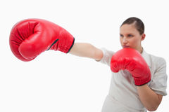 Businesswoman punching something Stock Image
