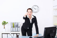 Businesswoman pushing abstract button. Stock Photo