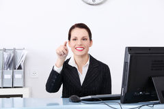 Businesswoman pushing an abstract button. Royalty Free Stock Image