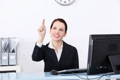 Businesswoman pushing an abstract button. Stock Images