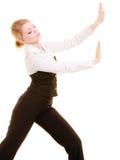Businesswoman pushing away blank copy space Royalty Free Stock Photos