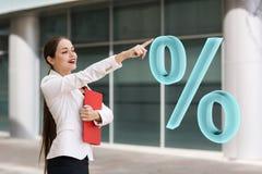 Businesswoman pushing big virtual percent. Stock Photography