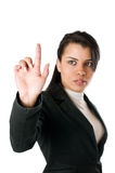 Businesswoman pushing a button Stock Photo