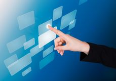 Businesswoman pushing button on transparent screen Royalty Free Stock Image