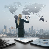 Businesswoman pushing icon on media screen, business globalization Royalty Free Stock Photo