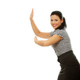 Businesswoman pushing something imaginary Royalty Free Stock Photo