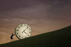 Businesswoman pushing time outdoor Stock Photo