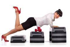 Businesswoman pushing up Stock Image
