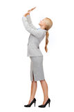 Businesswoman pushing up something imaginary Royalty Free Stock Image