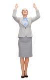 Businesswoman pushing up something imaginary Royalty Free Stock Photos