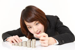 Businesswoman Put Coins To Stack Of Coins Royalty Free Stock Image