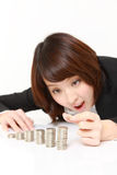 Businesswoman Put Coins To Stack Of Coins Stock Photography