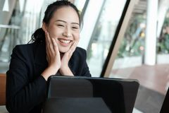 Businesswoman put hand on face with happiness for successful pro. Ject. cheerful woman showing gladness for achievement stock photography