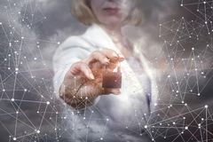 Businesswoman puts a protection network . Stock Images