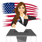 Businesswoman putting ballot in vote box Stock Photography