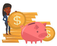 Businesswoman putting coin in piggy bank. Stock Image