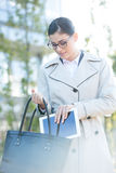 Businesswoman putting digital tablet in bag outdoors Stock Photos
