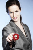 Businesswoman putting key into keyhole Royalty Free Stock Image