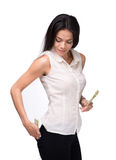Businesswoman putting money in pocket Royalty Free Stock Photo