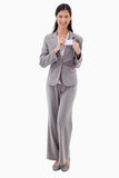 Businesswoman putting on name badge Royalty Free Stock Photography