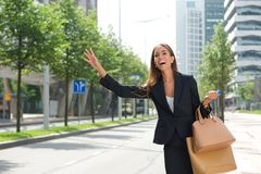 Businesswoman with raised arm calling for taxing Royalty Free Stock Photo