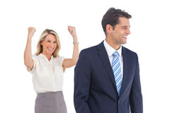 Businesswoman with raised arms and her coworker Stock Photos