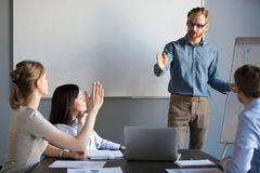 Businesswoman raising hand up at meeting asking team leader ques. Businesswoman raising hand up at meeting asking presenter team leader, mentor or coach royalty free stock photography