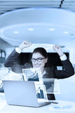 Businesswoman with raising hands and smilling Stock Photo