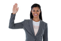 Businesswoman raising her hand. Against white background Royalty Free Stock Photography