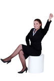 Businesswoman reaching into the air Stock Image