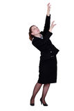 Businesswoman reaching for boxes Royalty Free Stock Images