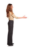 Businesswoman - reaching handshake. Isolated full length studio shot of a Caucasian businesswoman reaching out for a handshake stock images
