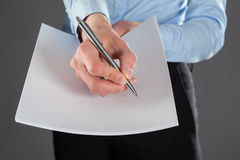 Businesswoman reaching out documents and offering to sign them Royalty Free Stock Image