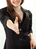 Businesswoman reaching out hand for handshake Stock Image