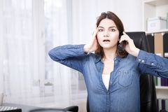 Businesswoman reacting in shock to a call Stock Photos