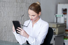 Businesswoman read bad news on tablet Stock Image