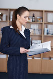 Businesswoman read catalog Royalty Free Stock Photography
