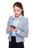 Businesswoman read on cellphone Stock Images