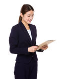 Businesswoman read on clipboard Stock Photo