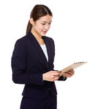 Businesswoman read on the document work Stock Photo