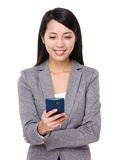 Businesswoman read on the message of smart phone Stock Images