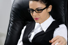 Businesswoman reading. Business woman  reading and studying news in office Stock Photography