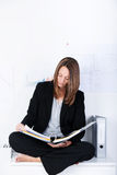 Businesswoman Reading In Binder Royalty Free Stock Images