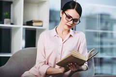 Businesswoman reading the book stock photos