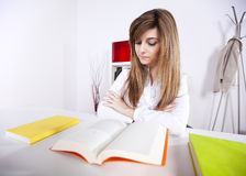 Businesswoman reading books Stock Image
