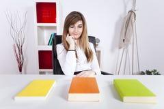 Businesswoman reading books Stock Photos