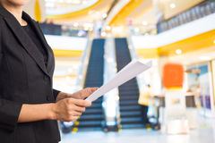 Businesswoman reading a business document. Royalty Free Stock Images