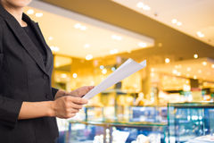 Businesswoman reading a business document. Stock Photos