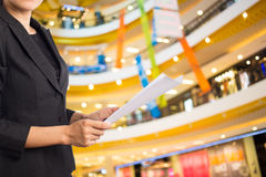 Businesswoman reading a business document. Royalty Free Stock Image